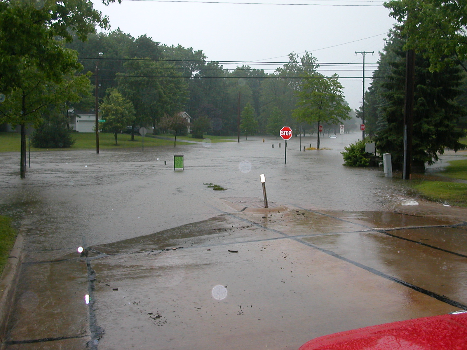 Flooded intersection with standing water