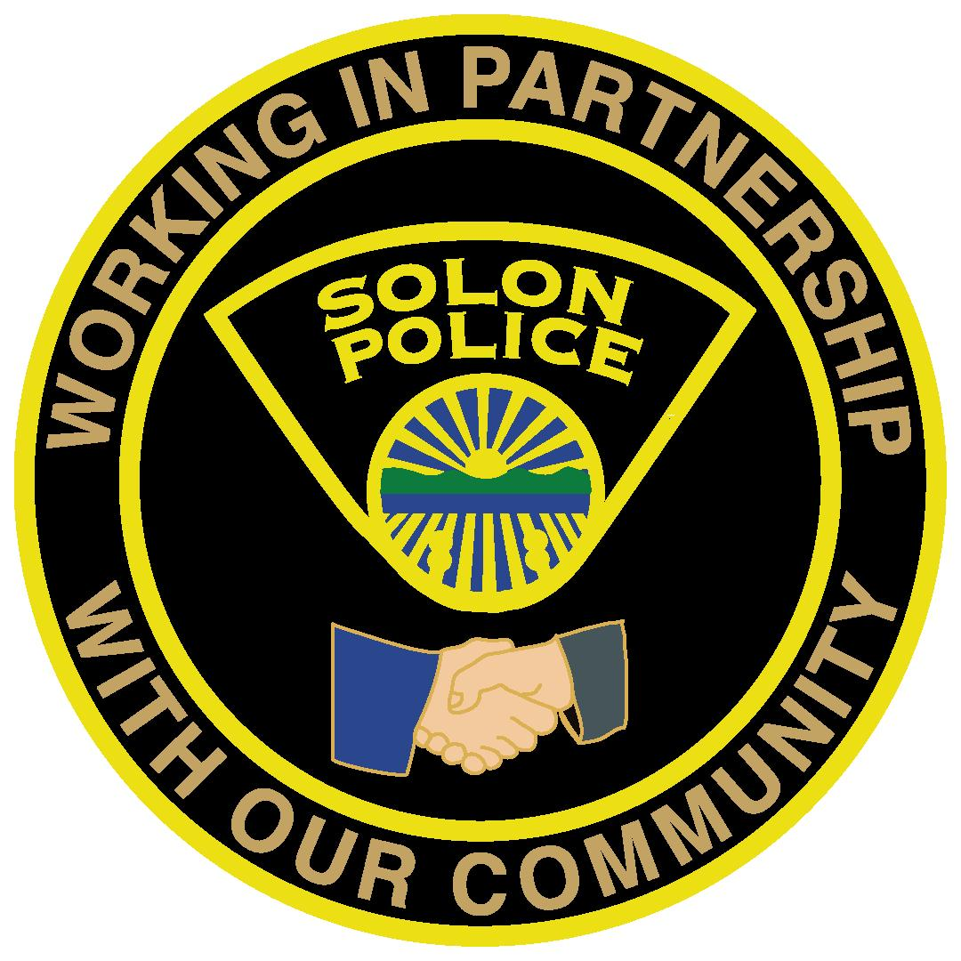 Citizens Academy Coin with text Solon police and image of hands shaking