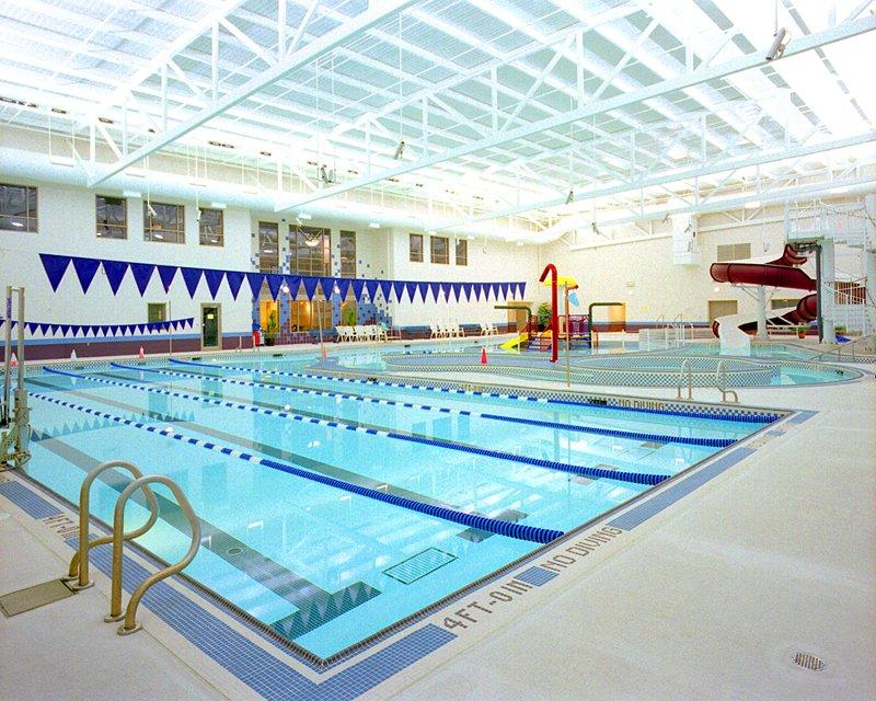 Indoor pool with swimming lanes roped off and marked