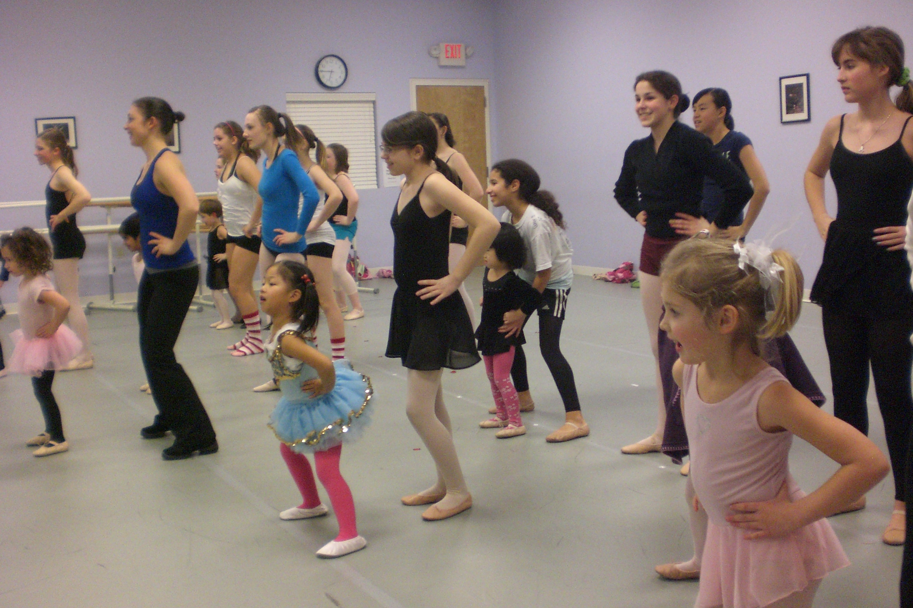 SCA's Dance Ensemble students help with the Creative Movement class.