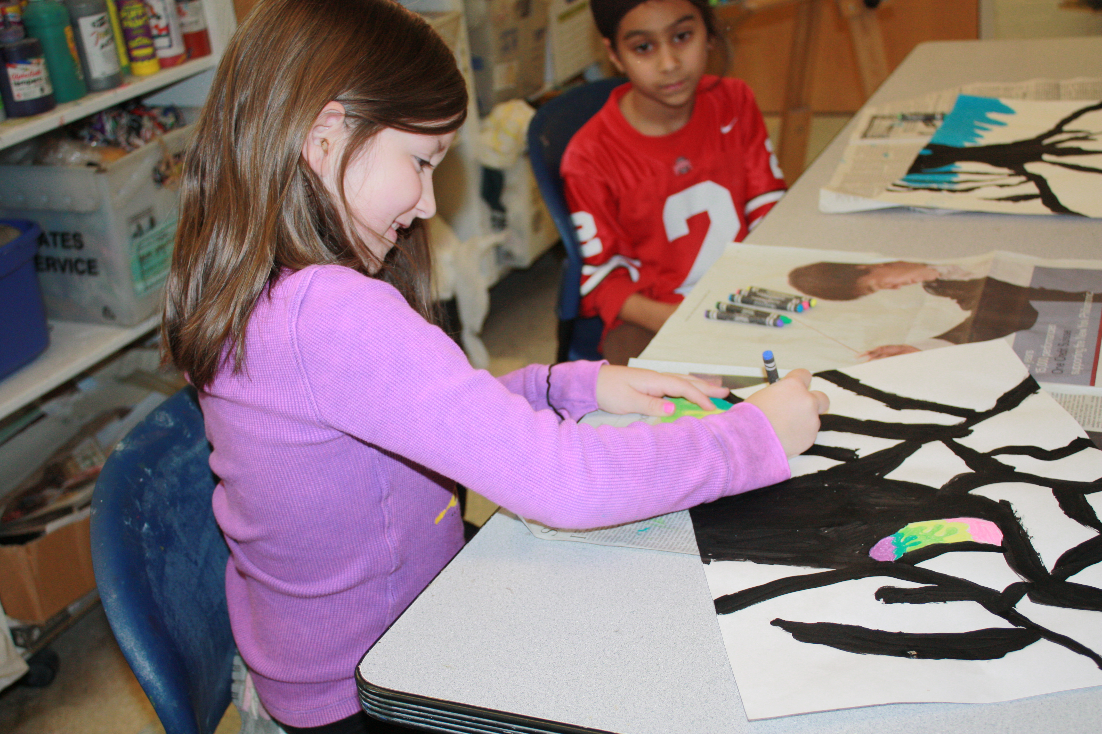 Students enjoy working on art in the Arts4Kids After School Program