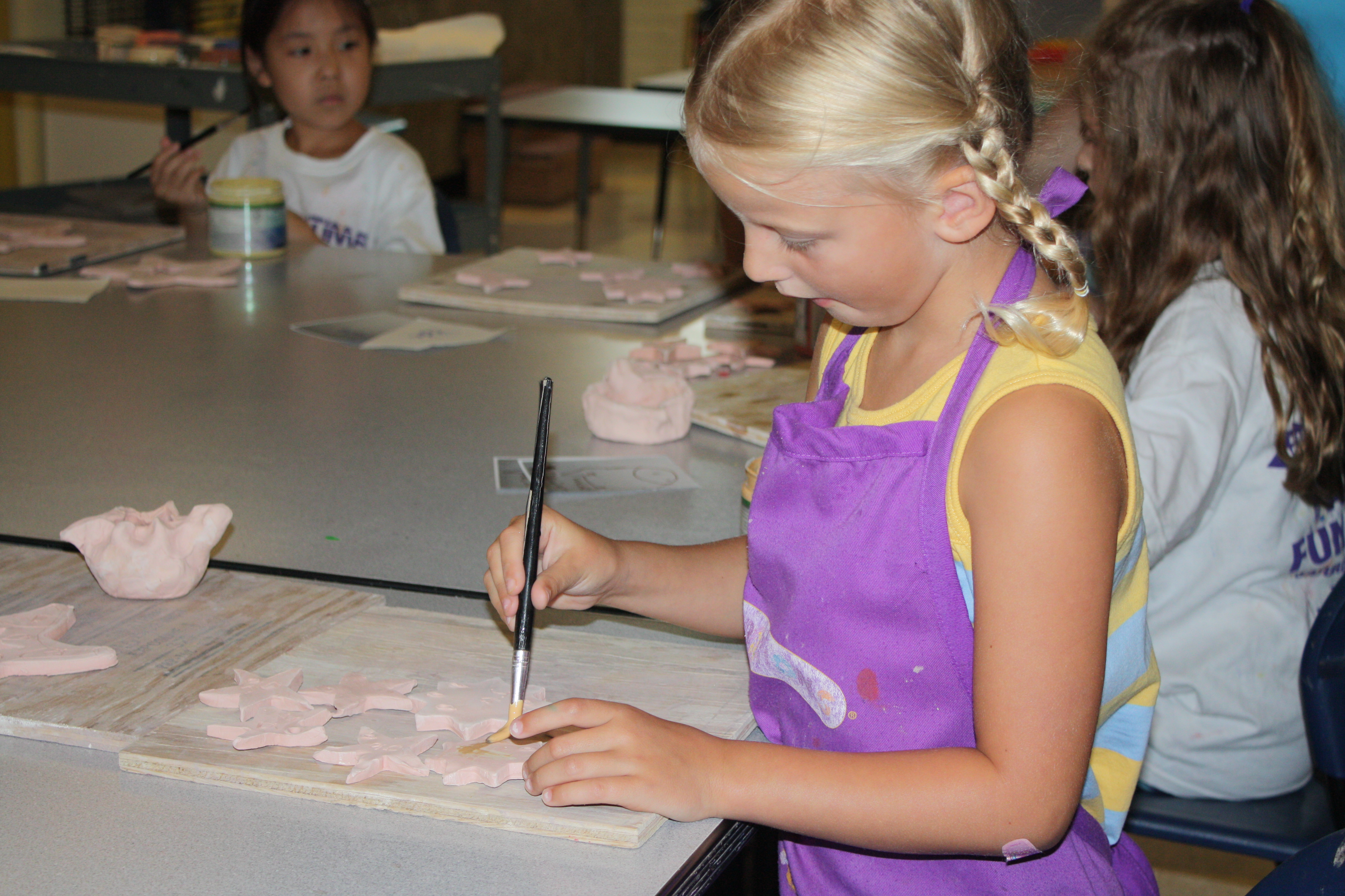 Students work with Clay