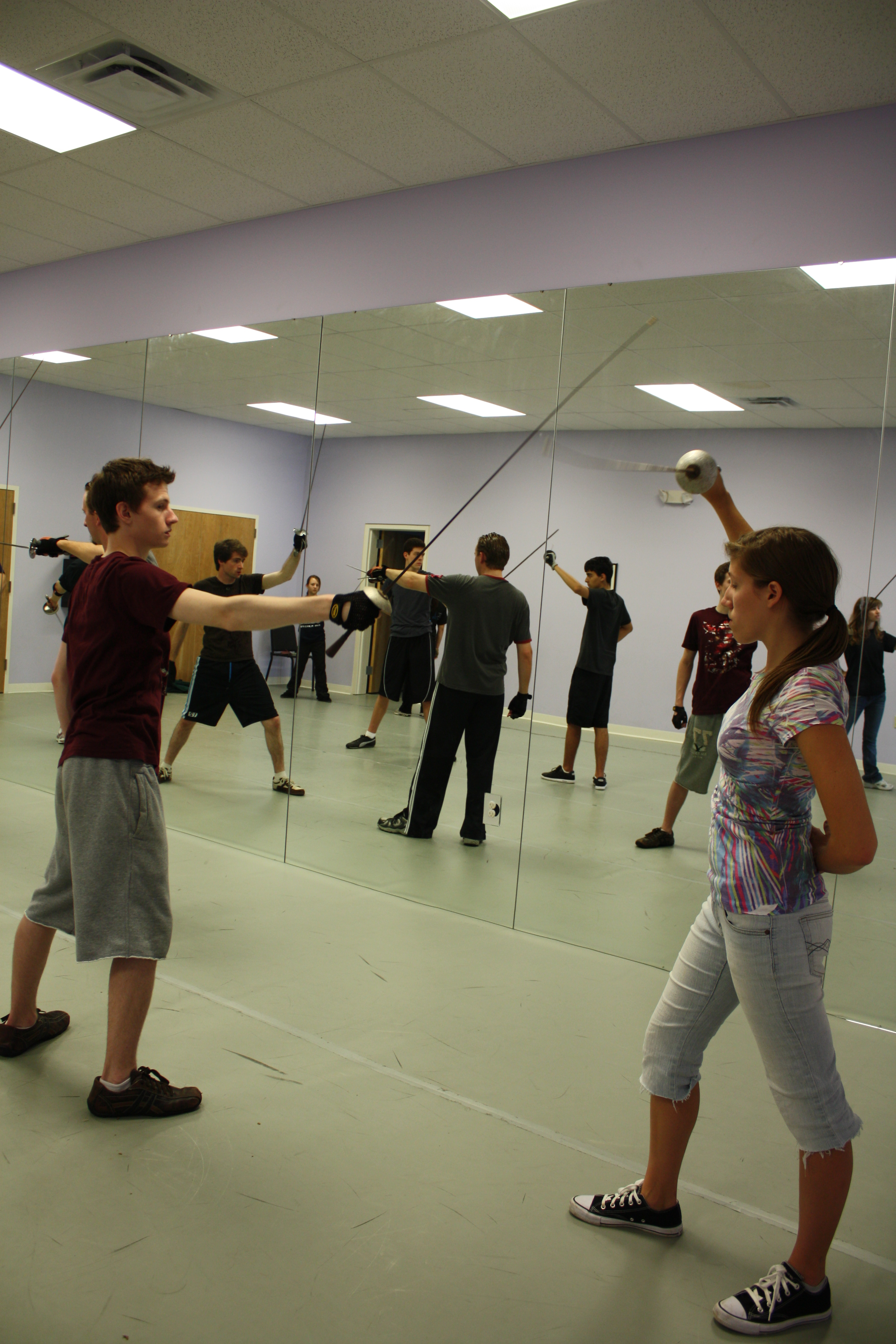 High school students participate in a stage combat workshop.